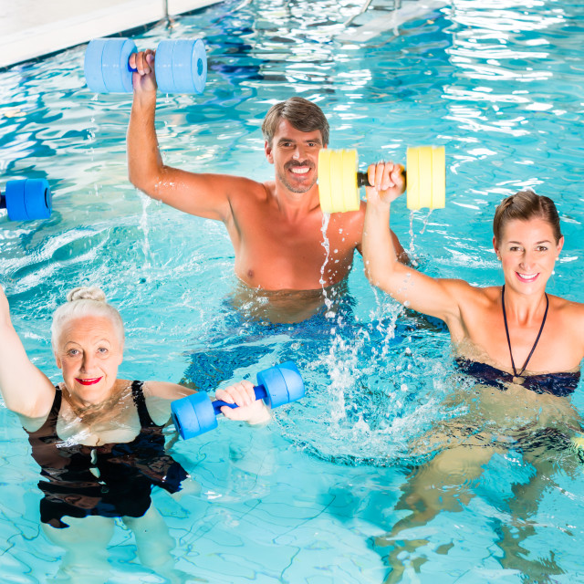 """Group of people at water gymnastics or aquarobics"" stock image"