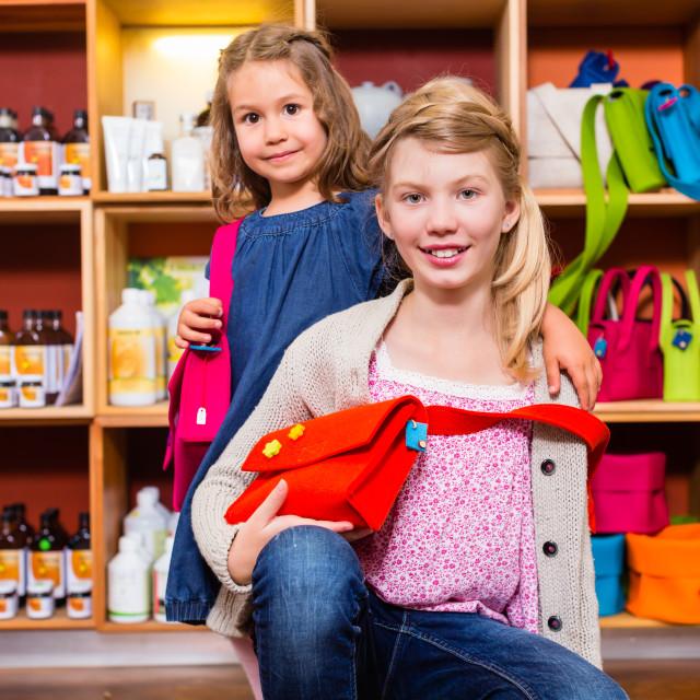 """""""Children buying supplies in handicraft store"""" stock image"""