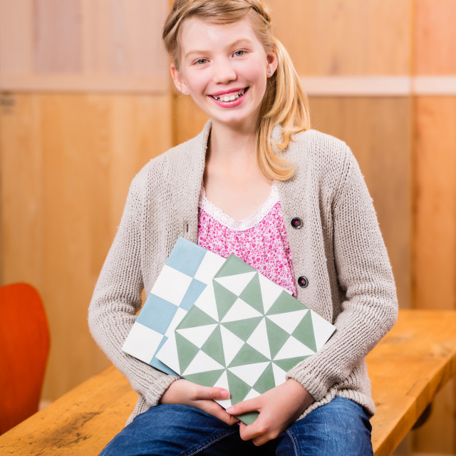 """""""Child with floor tiles in home improvement store"""" stock image"""