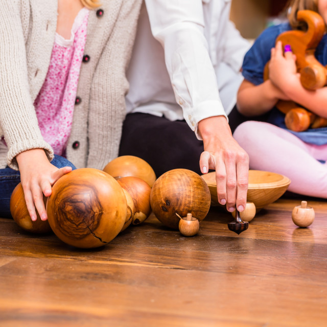 """""""Children playing with wooden toys in store"""" stock image"""