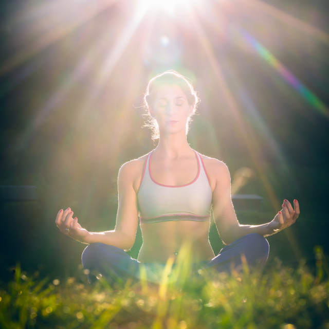 """Woman doing yoga in sunset"" stock image"