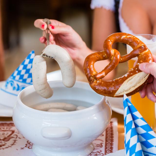 """People eating veal sausage in bavarian restaurant"" stock image"
