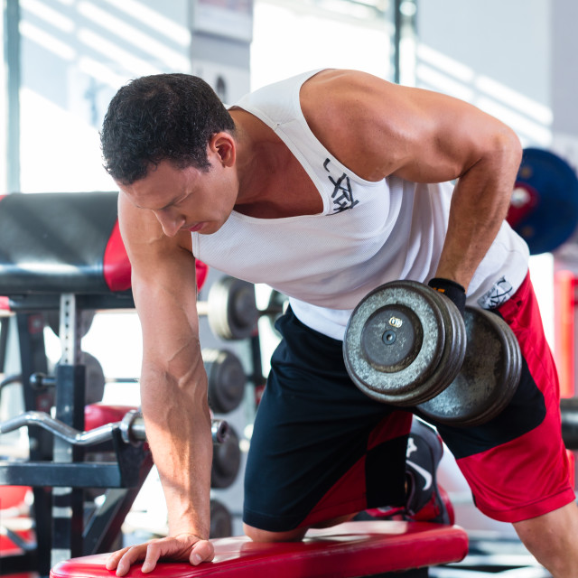 """""""man with dumbbells at sport in fitness gym"""" stock image"""