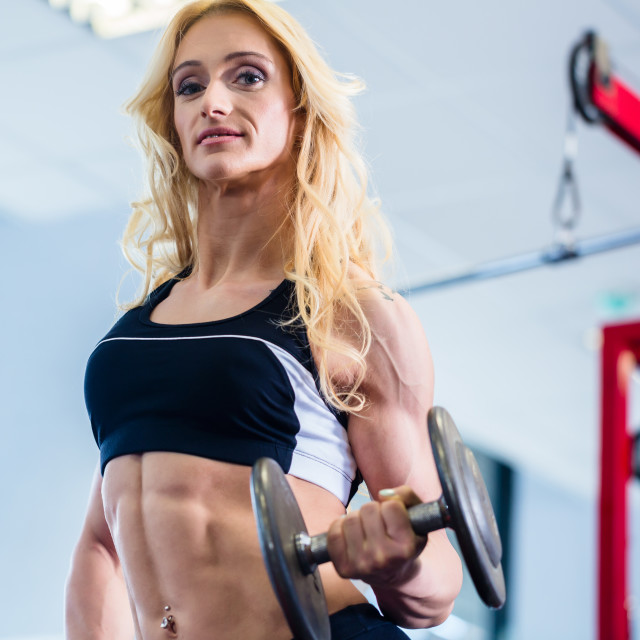 """""""Woman at bodybuilding lifting weights in gym"""" stock image"""