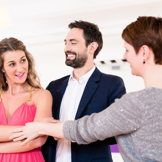 """Instructor in dance school with couple"" stock image"