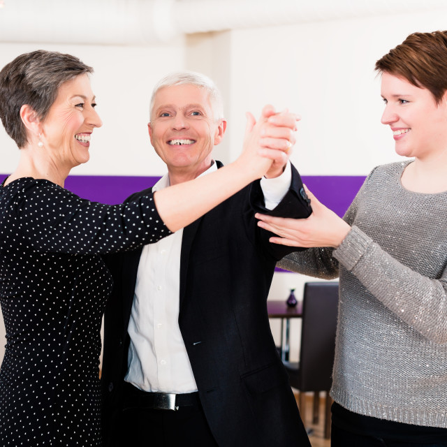 """Dance instructor with senior couple"" stock image"