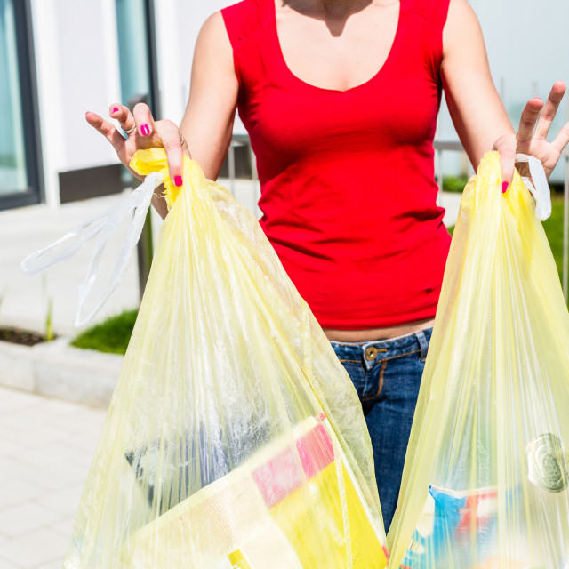 """""""Woman throwing the garbage away in container"""" stock image"""