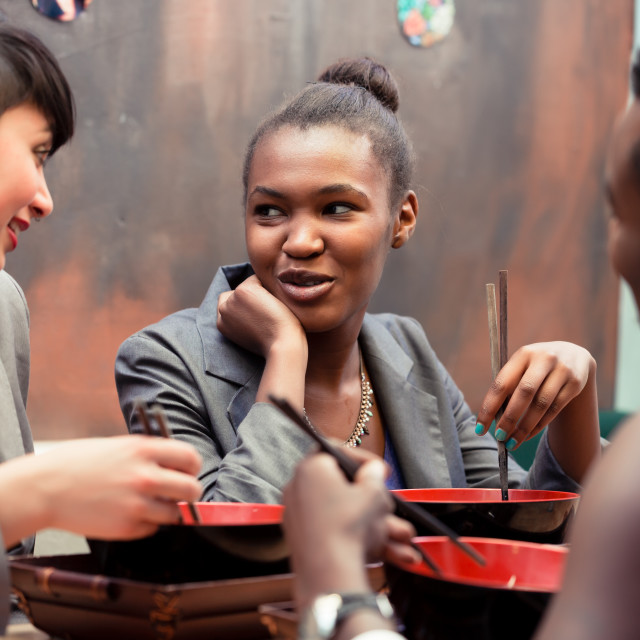 """""""Friends eating noodle soup in Japanese Restaurant"""" stock image"""