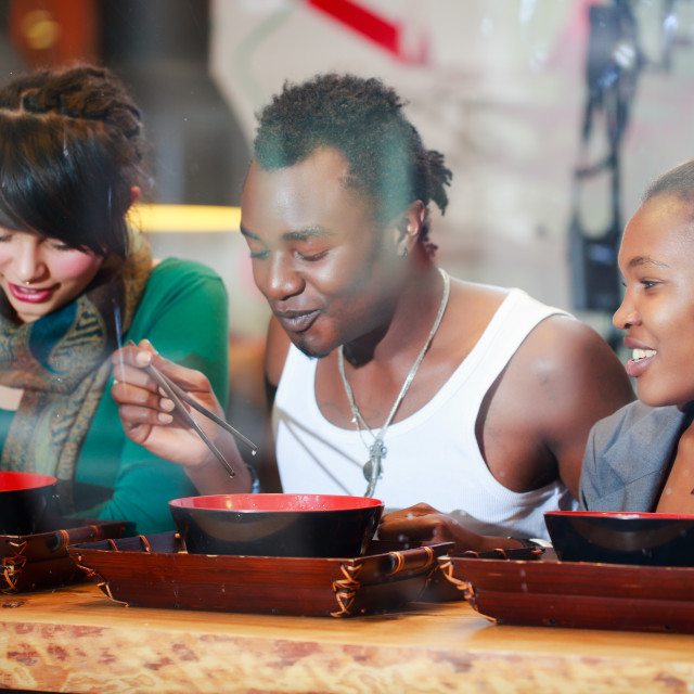 """""""Man and women eating late in Korean eatery"""" stock image"""