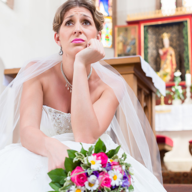"""""""Bride waiting alone for wedding being frustrated"""" stock image"""