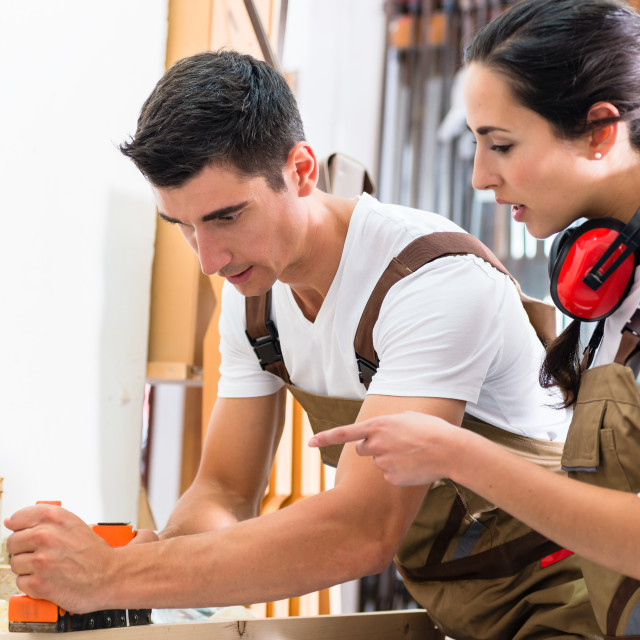 """""""Carpenter team of woman and man working together"""" stock image"""