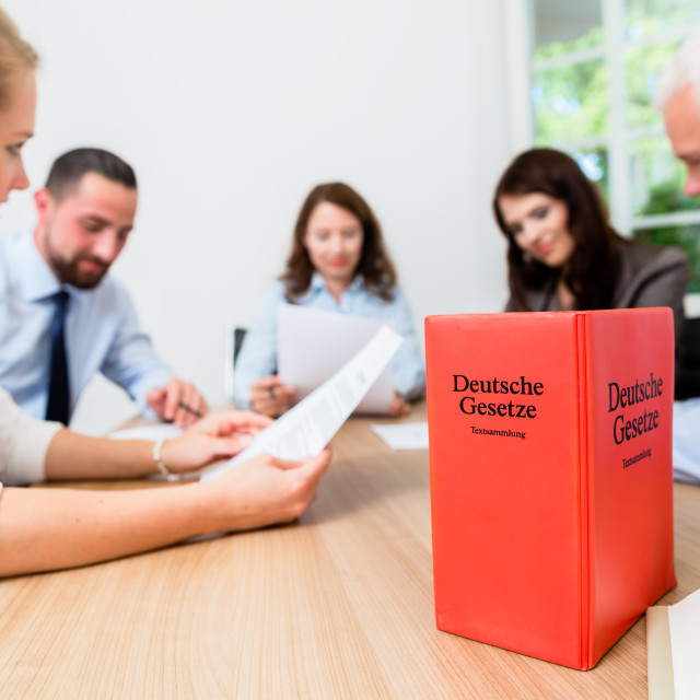 """""""Lawyers in meeting negotiating agreement"""" stock image"""