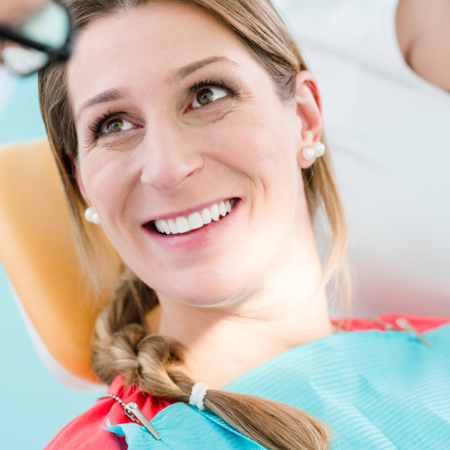 """""""Woman with healthy smile at dentist"""" stock image"""