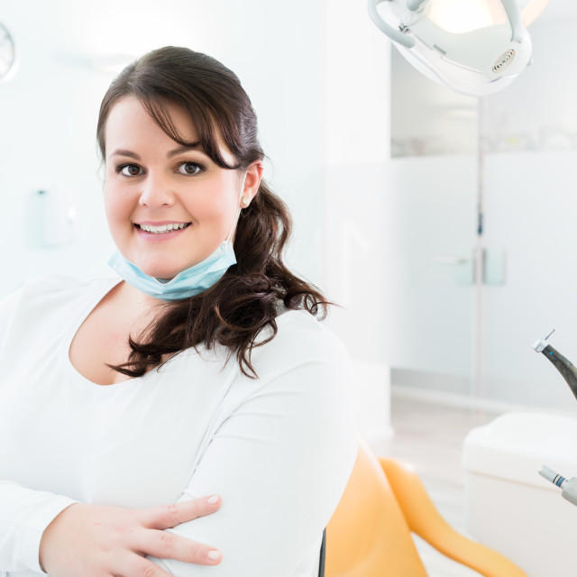 """""""Dentist or nurse standing in dental surgery"""" stock image"""