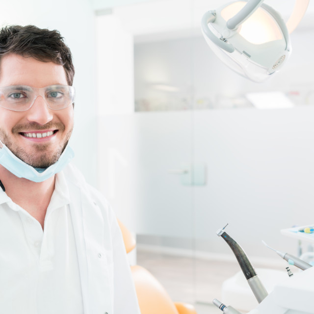 """""""Dentist standing in dental surgery"""" stock image"""