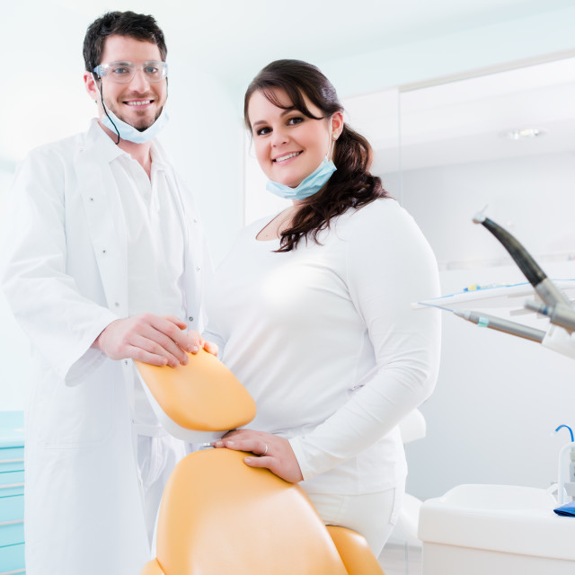 """""""Dentist and nurse in their clinic as team"""" stock image"""