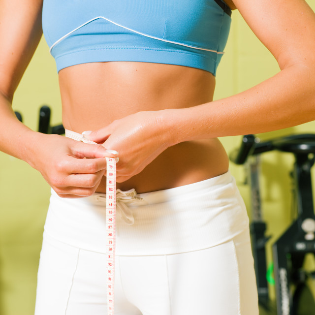 """Measuring waist"" stock image"