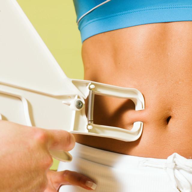 """Measuring body fat"" stock image"