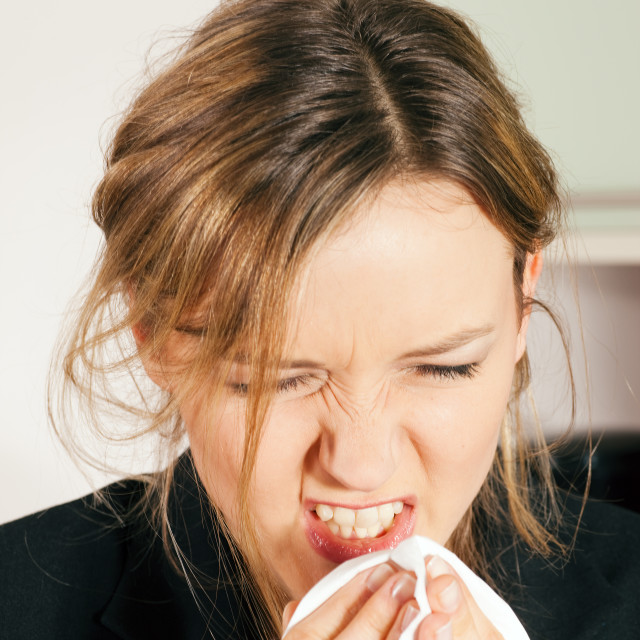 """Woman sneezing"" stock image"