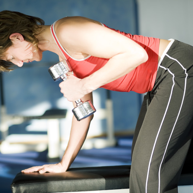 """""""Lifting the dumbbells"""" stock image"""