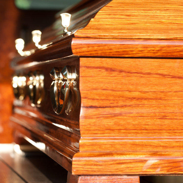 """Funeral with coffin in hearse"" stock image"