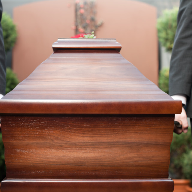 """coffin bearer carrying casket at funeral"" stock image"