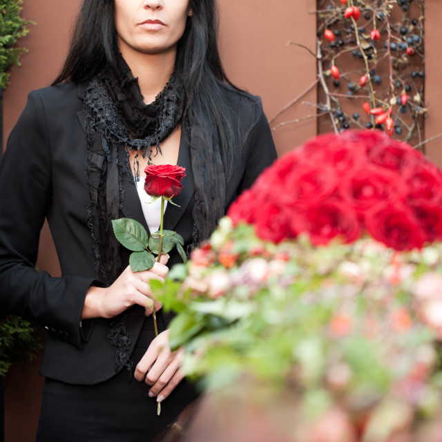 """Woman mourning on Funeral with coffin"" stock image"