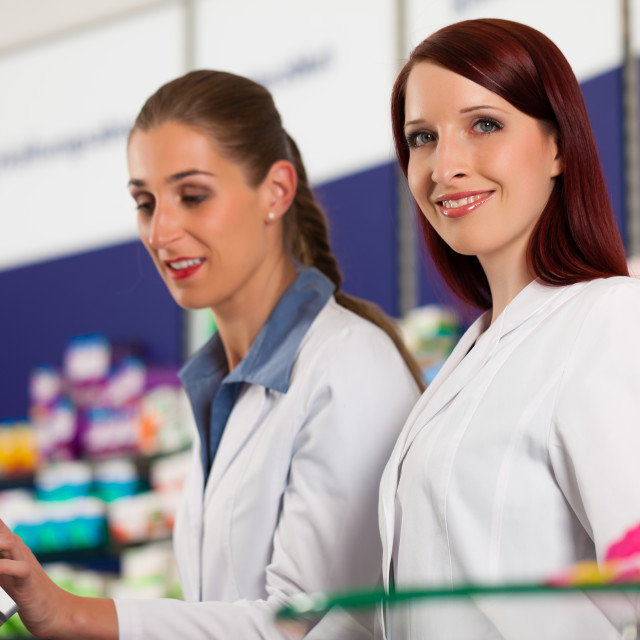 """Pharmacist with assistant in pharmacy"" stock image"