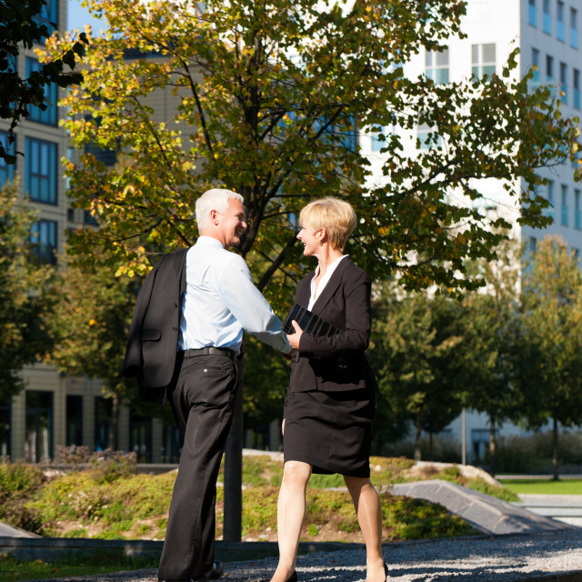 """Business people greeting outdoors"" stock image"