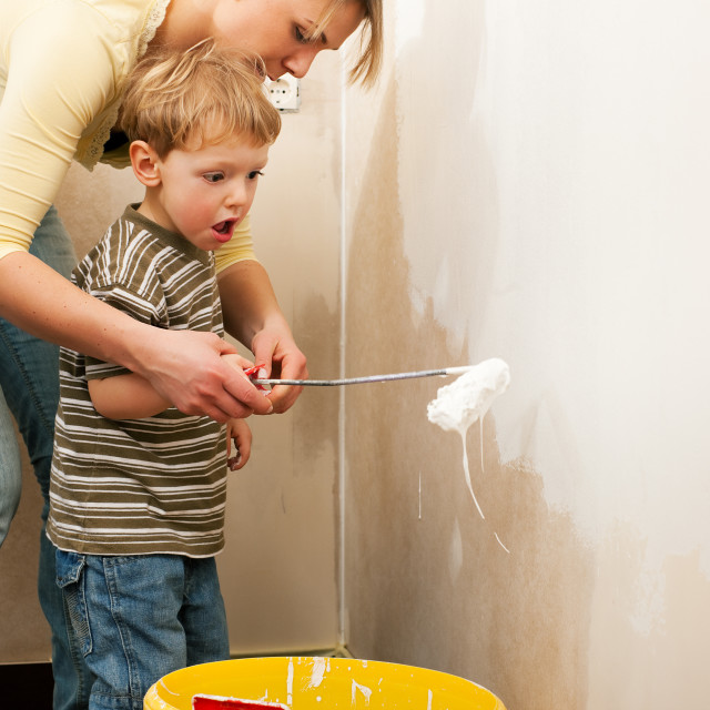"""Family painting wall of new home"" stock image"