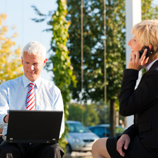 """Business people working outdoors"" stock image"