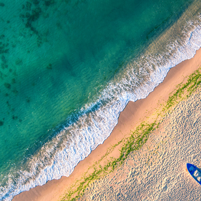 """Aerial view of ocean waves and sand on beach"" stock image"