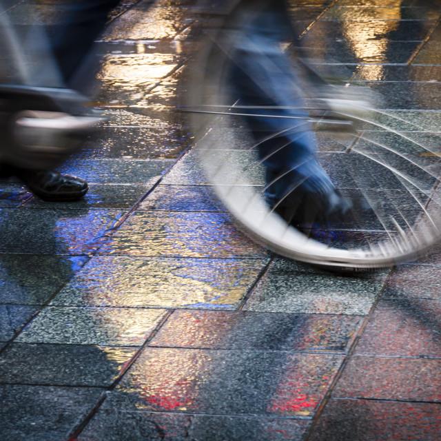 """Pushing bicycle on neon reflections"" stock image"