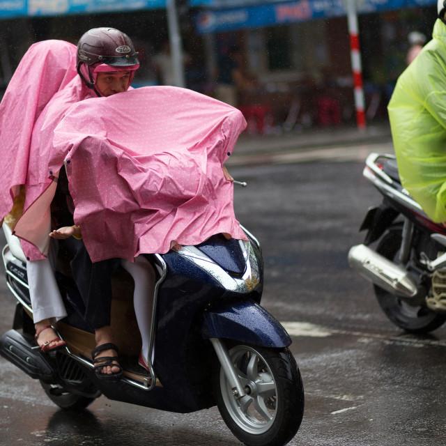 """Riding motorbike under heavy rain"" stock image"