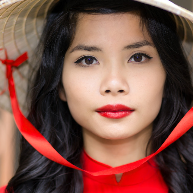 """Pretty Vietnamese woman in a straw hat"" stock image"
