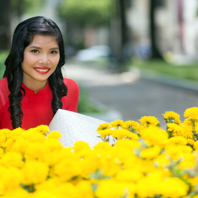 """Attractive Vietnamese woman with yellow flowers"" stock image"