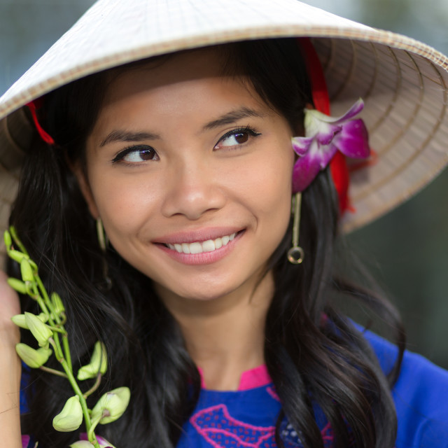 """Pretty Vietnamese woman with a flower in her hair"" stock image"