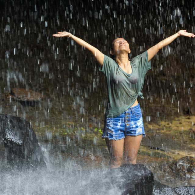 """Freedom under waterfall"" stock image"