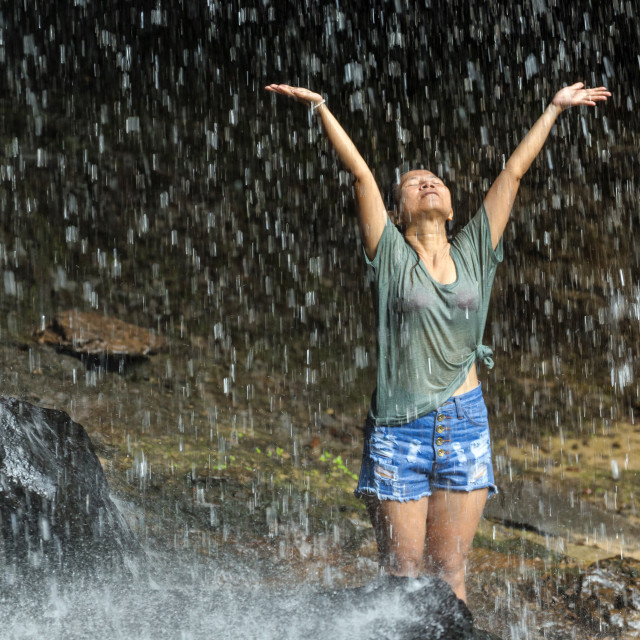 """Happy woman under waterfall"" stock image"