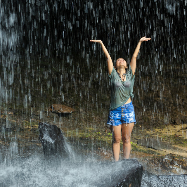 """Woman freedom under waterfall"" stock image"