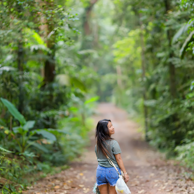 """Woman walking in jungle"" stock image"