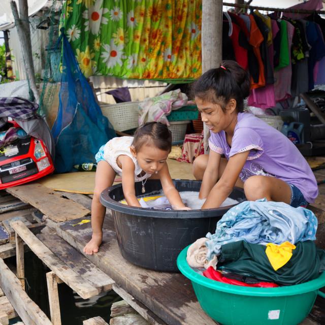 """""""Asian girls washing laundry"""" stock image"""