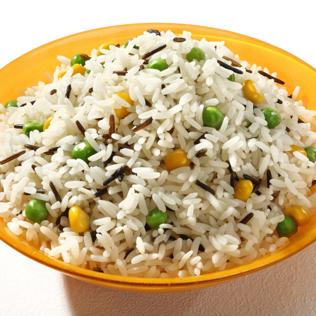 """Dish of black & white rice in an orange plate on white background. Close up, high resolution product."" stock image"