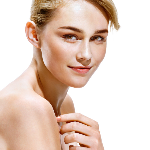 """Beautiful blonde girl. Close up of an attractive girl of European appearance on white background. Youth and skin care concept"" stock image"