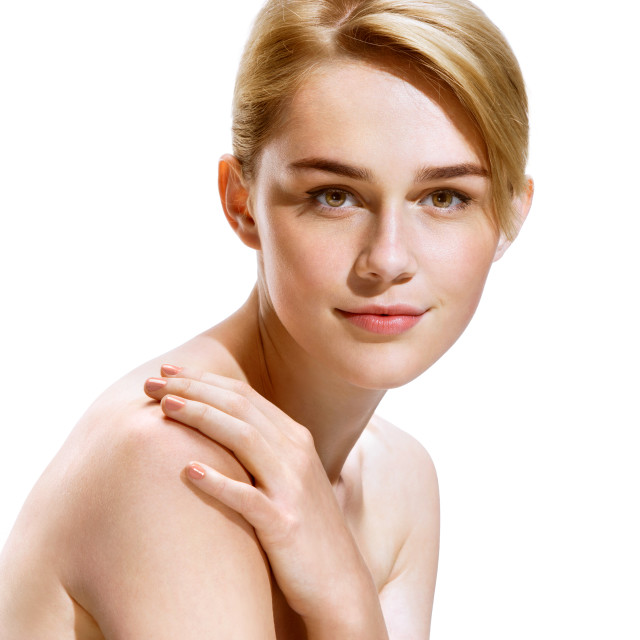 """Beautiful girl with natural make up, looks at camera. Photo of attractive blonde girl on white background. Youth and skin care concept"" stock image"
