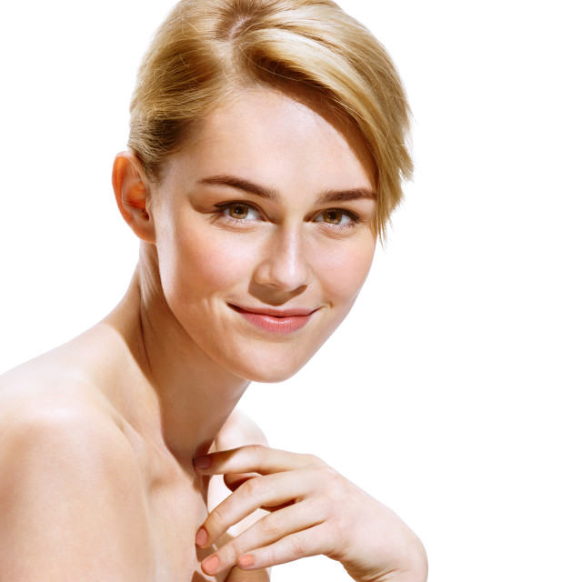 """Perfect skin. Beautiful young lady cares for her skin on white background. Youth and skin care concept"" stock image"