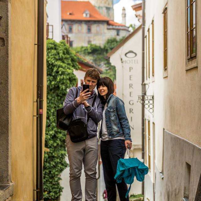 """Romantic couple taking a selfie of Český Krumlov"" stock image"