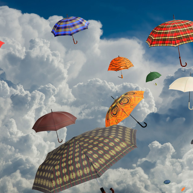 """abstract,umbrellas carried away by wind"" stock image"