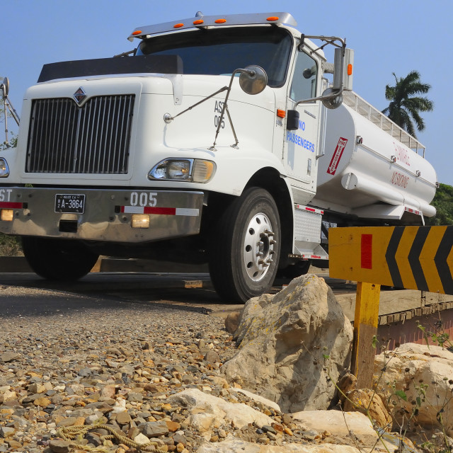 """Small petroleum truck en route"" stock image"