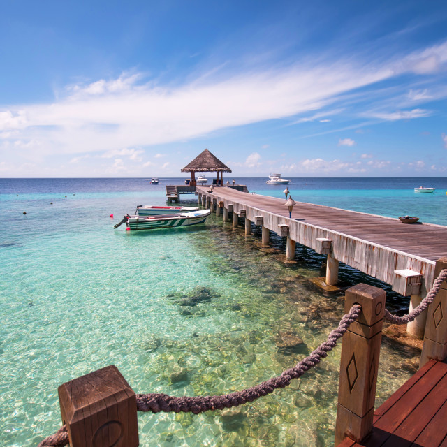 """""""Wooden jetty over blue coral lagoon"""" stock image"""
